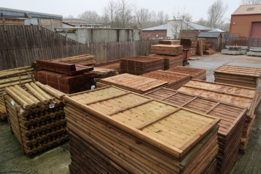 whole yard picture view of pannels and posts - ealrs colne fencing material supplier yard - tarmec and croft fencing and gates ltd 01787 224848