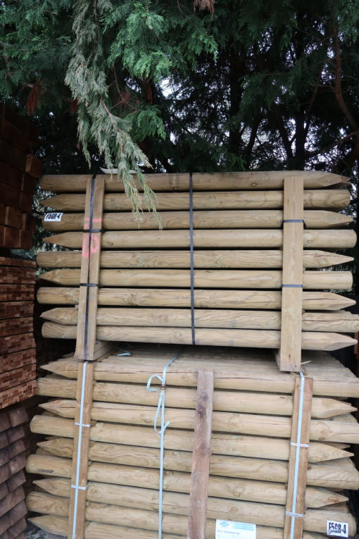 round posts wooden - side view stacked - tamrec and croft fencing and gates ltd 01787 224848