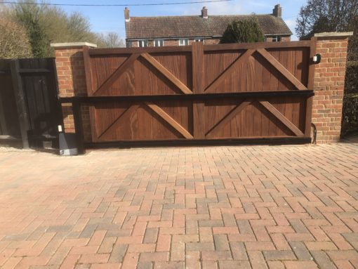 Rear of Straight Top Hardwood Entrance gates with automation Dunmow Tarmec and Croft Fencing and Gates Ltd