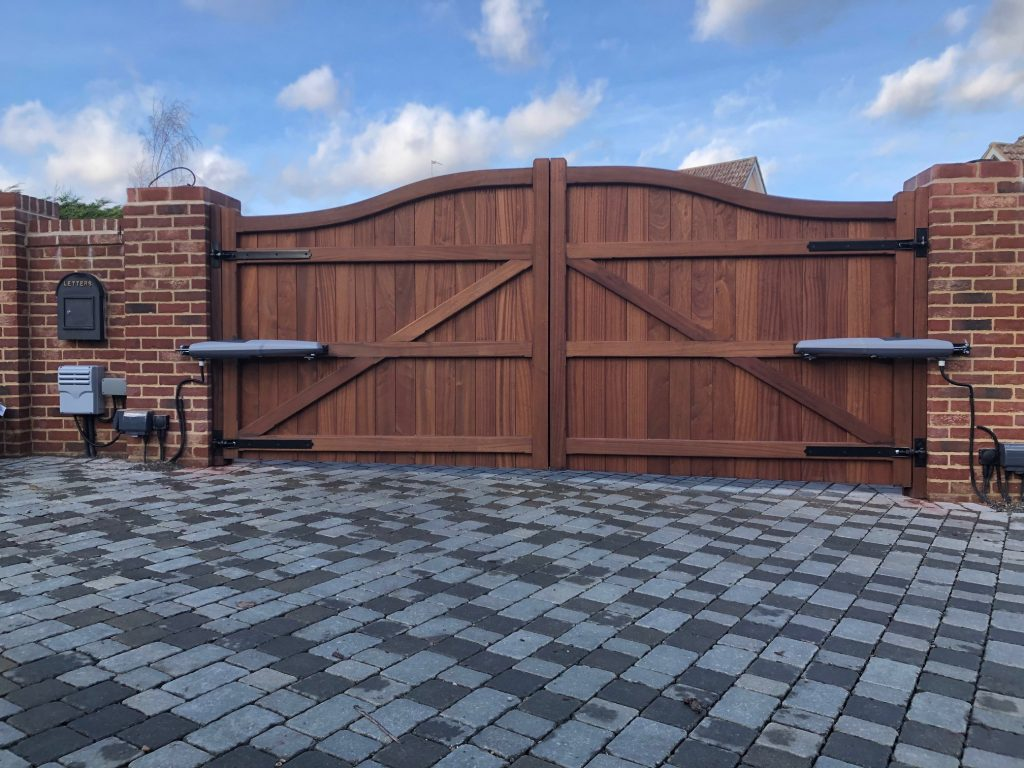 Rear view of hardwood Bow Tops with automation Tarmec and Croft Fencing and Gates